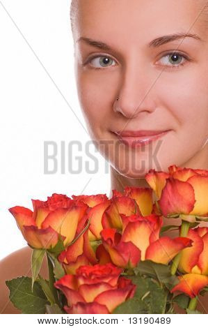 Attractive young girl with a boquet of roses