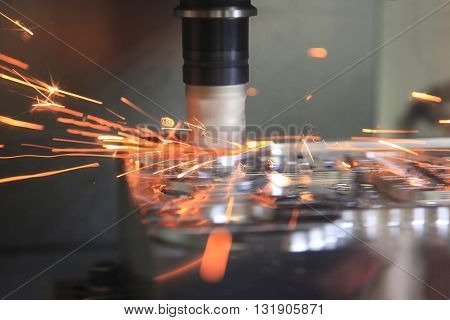 Cutting metal on the milling machine at high speed. Focus blurred to show the speed of the process