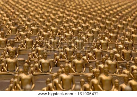 Million golden Buddha figurine in Wat Phra Dhammakaya. Buddhist temple in Bangkok Thailand