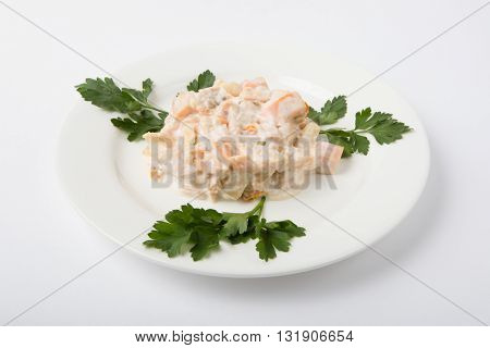White russian salad served on a white plate