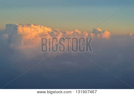 sky with clouds at sunset or sunrise. take photo from windows of airplane