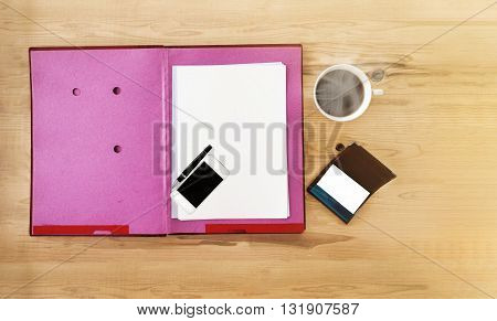 Top view blank paper note on file foldercellphonemobile phone white cup of black coffee penempty business card on wooden table ans copy space empty area