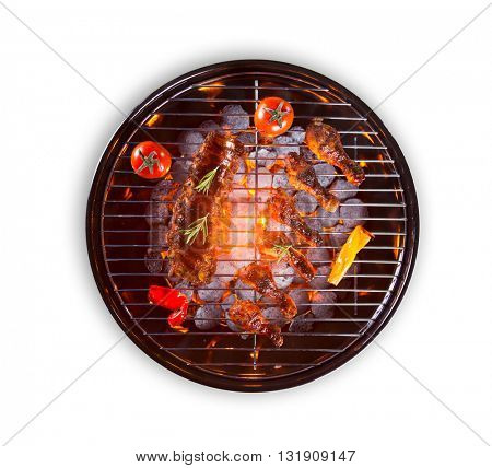 Various kind of meat and vegetable served on grill, isolated on white background