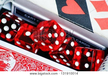Cards and red dice poker on the table