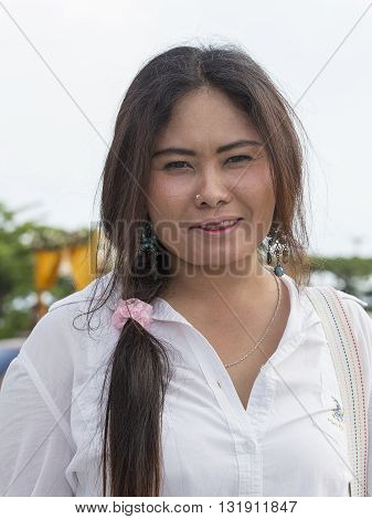 KOH PHANGAN THAILAND - DECEMBER 09 2015 : Unknown Thai woman takes part in the Phangan Color Moon Festival
