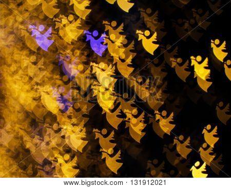 Blurring lights bokeh background of golden angels