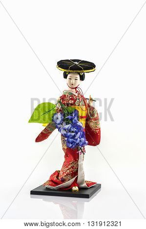 Japanese geisha dolls with wisteria blossome on white background.