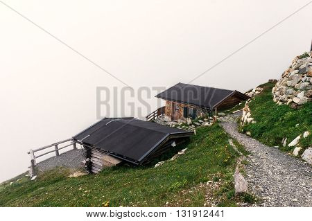 View on house roofs in fog on the edge of a mountain in Austria