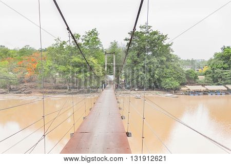 Long Rope Bridge Across The River In Village At Thailand Countryside, Folk Way Across Waterfall, Khe