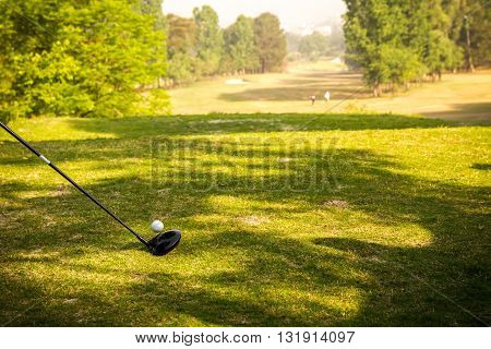 Golf Stick and Ball on the green grass field background of Nepal.