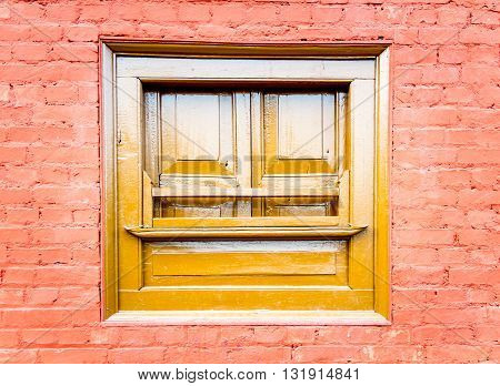 Front view of closed architectural wooden window of Nepal.