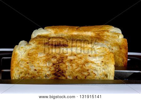 Two slices of toasted bread in a pop up toaster