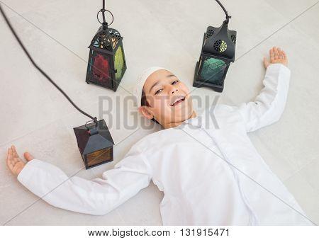 Happy child ready for Ramadan with lantern