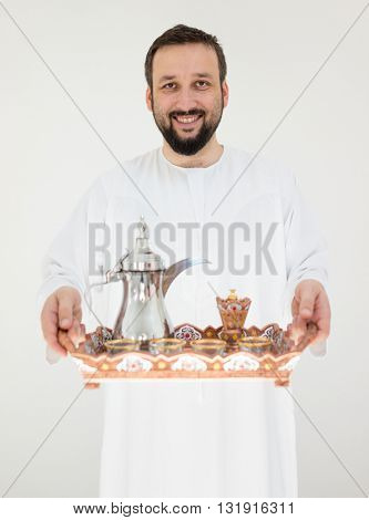 Arabic man with traditional coffee for hospitality