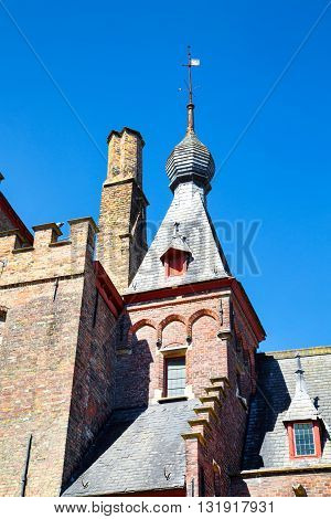 Traditional medieval  brick house exterior against blue sky in belgian destination Brugge, Belguim