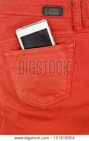 Cell phone in back pocket of red jeans
