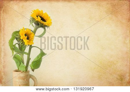 Painterly still life with a vase of sunflowers and grunge background