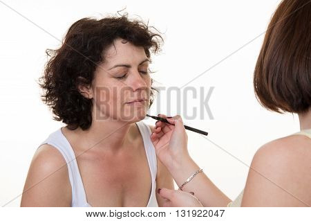 Happy And Relaxing Middle-aged Model, With A Makeup Artist