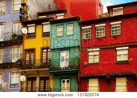 colorful old houses facade in old town, Ribeira embankment, Porto, Portugal, retro toned