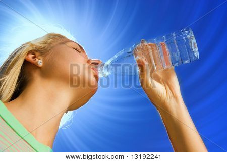 Beautiful blond girl drinking water