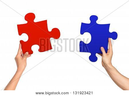 female and male hands holding jigsaw isolated on white background