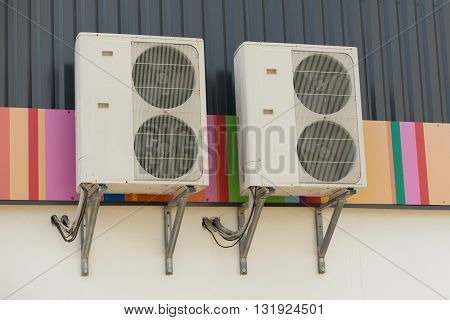 Air conditioning compressor outdoor on the wall