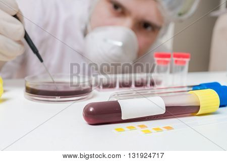 Scientist Or Researches Is Analyzing Blood In Test Tube.