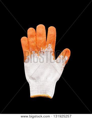 Yellow rubber protective gloves on a black background