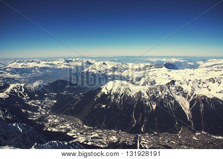 Chamonix valley panoramic aerial view from Aiguille du Midi mountain peak. Popular touristic destination.