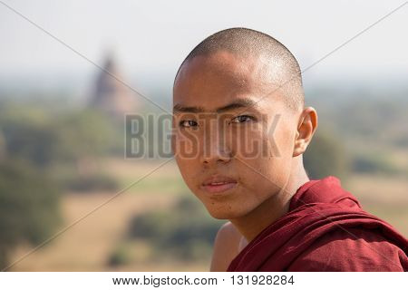 BAGAN MYANMAR - JANUARY 19 2016: Unidentified portrait monk visit the Bagan Pagoda