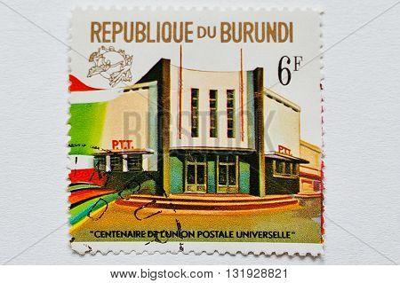 Uzhgorod, Ukraine - Circa May, 2016: A Post Stamp Printed In Burundi Shows Post Ofice Bildings Burun