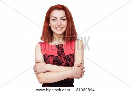 Beautiful young woman in pink dress posing with crossed hands on isolated background