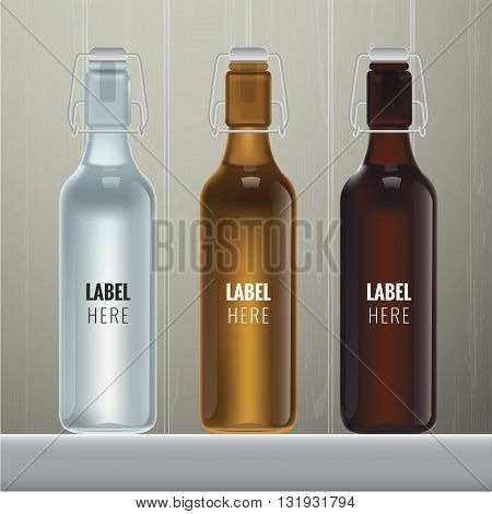 Vector blank glass bottles in three colours on wood background