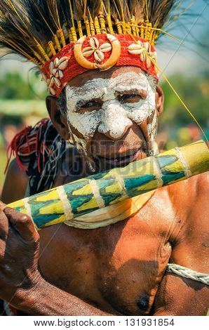 Old Man With Flute In Papua New Guinea