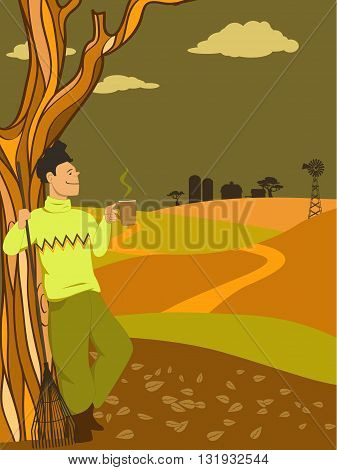 Man taking a break from raking leaves, drinking a hot beverage, looking at a countryside view