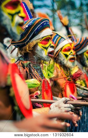 Men In Row In Papua New Guinea