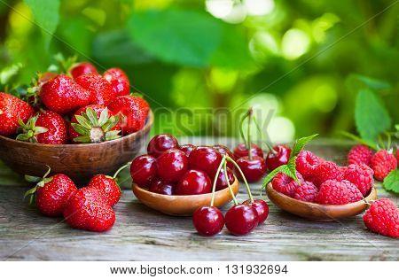 Organic fresh fruit, strawberries, raspberries and sour cherries