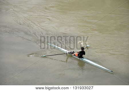 Sportsman Kayaking On The Tiber River In Rome
