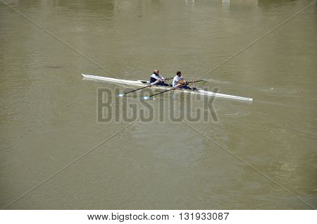 ROME ITALY - MARCH 14 2016: Team canoeing on the river Tiber in the city of Rome Italy