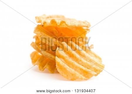 Crinkle cut potato chips isolated on white background. Pile of tasty potato chips.