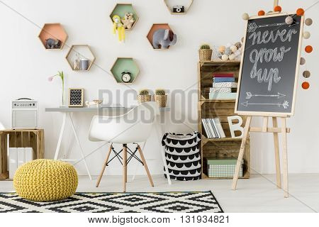 Shot of a modern comfortable room for kids with colorful shelves