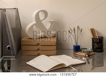 Glass desk with personal items illuminated with natural light