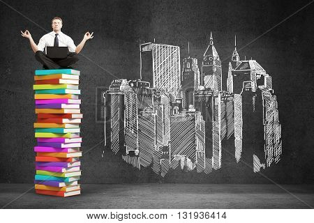 Businessman sitting on colorful book stack. Drawing city on concrete wall. 3D Rendering