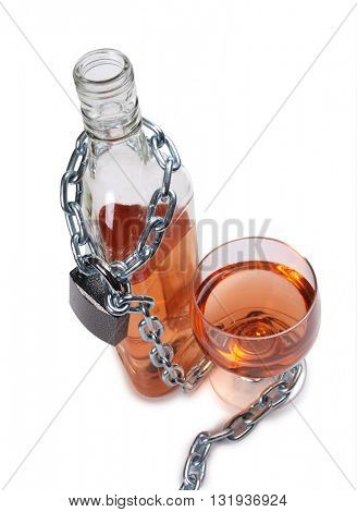 Wineglass of whiskey and metal chain n white background