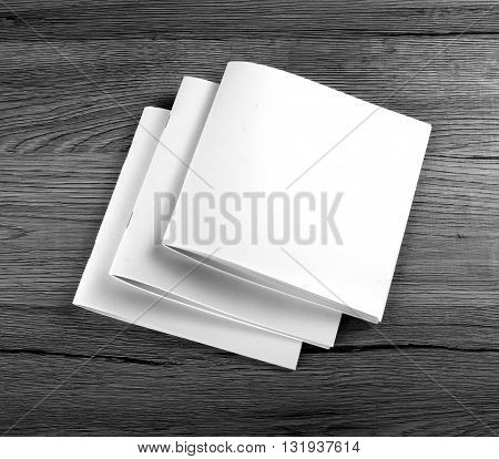 Blank Brochure magazine on wooden background to replace your design