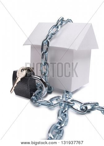Paper model house and padlock on white background