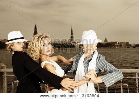 Threesome tango near the river