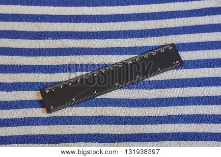 black inch cm ruler on blue white striped vest