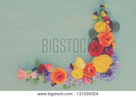 Flowers festive composition on blue table with copy space, retro toned