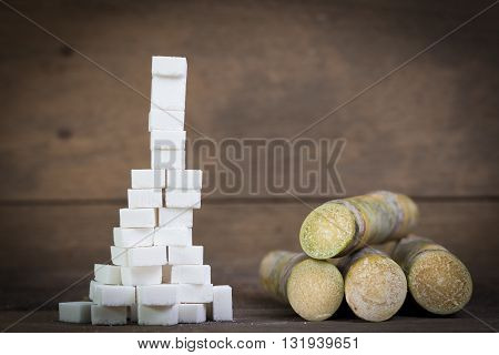 Sugar Cubes And Sugar Cane , Concept For Compare Chemical And Natural
